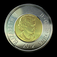 The new two-dollar coin struck with the patented multi-ply plated steel technology.