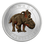 The new coin as it appears in the light and in the dark.