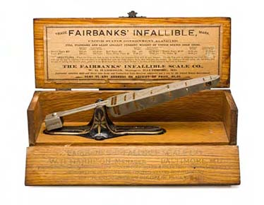 US Fairbanks coin counterfeit detector scale with balance peg, salesman sample kit with wood presentation box & pricing info. McNally/Harrison design patent. February 28, 1882. Design # 12,795. In light of the large number of counterfeit coins in circulation, coin counterfeit scales were popular. Courtesy of ANS. Gift of Anthony Terranova.