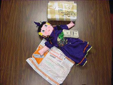 Photo of doll, which is stuffed with counterfeit money.
