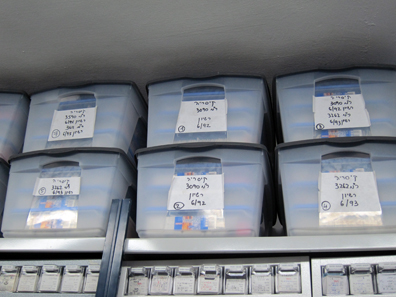 The unidentified coins are stored in large boxes. Photo: UK.