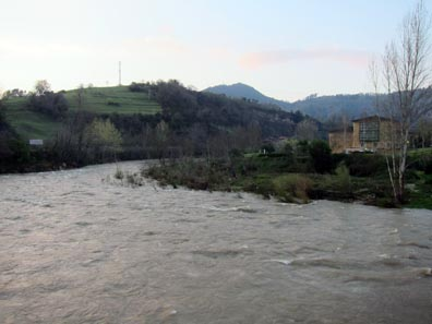 The Parador of Cangas de Onís, in Foreground, the Swollen River. Photo: KW.