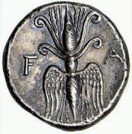 Eine Drachme aus Elis, der Landschaft, in der das antike Olympia liegt, aus der Zeit 245-210 v. Chr. Auf der Vorderseite ein Adler, das dem Zeus heilige Tier, mit einem erbeuteten Hasen, auf der Rückseite ein geflügelter Doppelblitz, das Symbol von Zeus.
