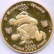 Zentralafrikanische Republik, 5000 Francs 1970, 900er Gold, 17,5 g. Auf der Vorderseite ist der Staatspräsident (der sich später zum Kaiser ernannte) abgebildet, auf der Rückseite ein Ringerpaar nach einer antiken Darstellung.