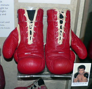 A pair of Muhammad Ali's boxing gloves, on display at the National Museum of American History, Washington, DC. Photo: Mark Pellegrini / Wikipedia. Creative Commons CC-BY-SA-2.5.