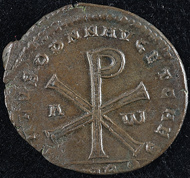 Christogram. Reverse of a bronze coin, Magnentius, Amiens (350-353 CE). KIKPE Collection.