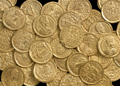 55 of the coins from the hoard, most of them were minted in the Western Empire in the late fourth century. © St Albans Museums Service.