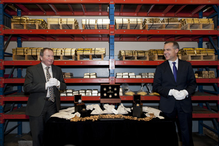 Ian E. Bennett, President of the Royal Canadian Mint Board and Marc Carney, Governor of the Bank of Canada unveil Canada's first gold coins at the Mint's Gold Refinery Vault in Ottawa, Ontario on November 28, 2012.