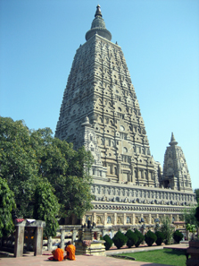 The Mahabodhi temple in Bodhgaya, India. Two monks are meditating in front of it. The tree under which the Buddha attained enlightenment is on the left, behind the monks. This temple is the number 1 pilgrimage site of Buddhism in the world. Photo: Wikipedia / http://creativecommons.org/licenses/by-sa/2.5/deed.en.