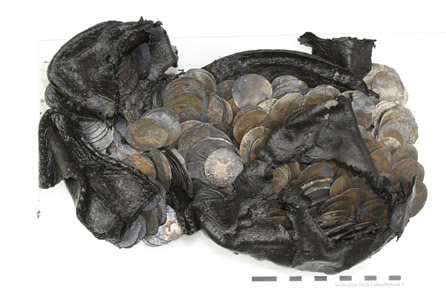 The Rotterdam coin hoard: 477 silver coins dating from the 15th and 16th centuries hidden in a shoe. © BOOR.