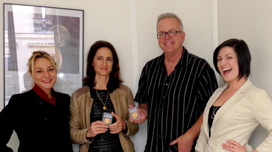 With two of the just-certified Champagne Lanson U.S. gold coins in Paris: Muriel Eymery, PCGS V.P. International Business Development; Catherine Yaiche, Bonhams France Head of Operations; Michael Sargent, PCGS Director of Grading; and Stephanie Robinson of PCGS Operations. Photo © PCGS.