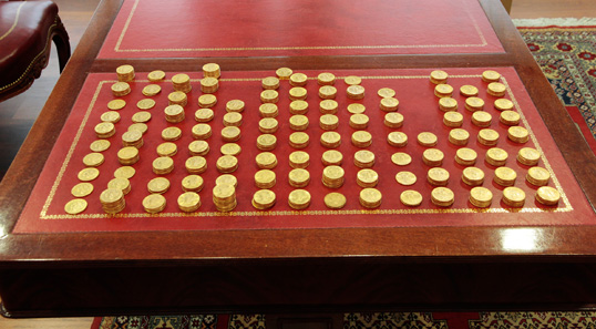 The array of U.S. gold coins found in an attic in France. The coins now have been certified by PCGS on behalf of Bonhams and Champagne Lanson. Photo © Lanson-BCC Group.