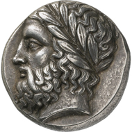 Olympia. Coin of the guardians of the Shrine of the Eleans (Peloponnesos). Stater, around 360 BC. Head of the bearded Zeus of Olympia with laurel wreath facing left. Reverse, Eagle sitting, facing right. © MoneyMuseum, Zürich.