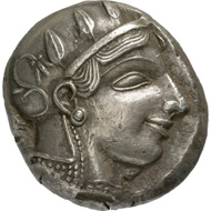 Athens. Tetradrachm, around 450 BC. Head of the goddess Athena with helmet, facing right, on the helmet are a palmette and three ornamental leaves of the olive tree. Reverse, sitting owl, facing right, a branch of the olive tree behind it with leaves and fruit, as well as a crescent moon. © MoneyMuseum, Zurich.