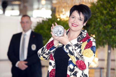 Marianne Rapp Ohmann showing one of the 5 ounce pieces with the popular Panda motif that was part of a comprehensive China collection.