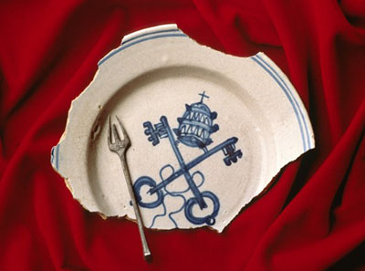 Among the glazed ceramic ware is a Sevilla Blue-on-White plate which has a
